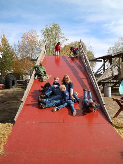teachers and students playing together at the pumpkin patch
